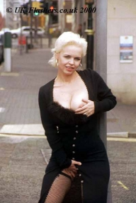 Mature flasher Ayes outdoors teasing voyeurs in amateur granny public nudity with old blonde babe outside showing ass and tits - Public Nudity